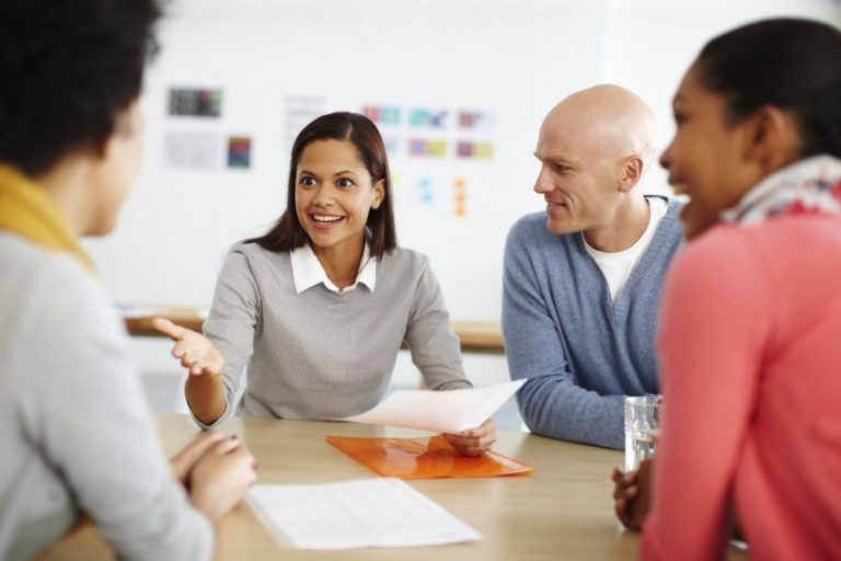 A group of businesspeople discussing work during a meeting